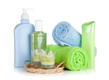Bathroom bottles, towels and candles stock photo