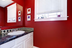 Bathroom with bright red walls Royalty Free Stock Photo