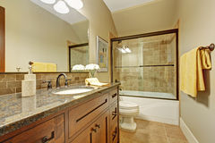 Bathroom cabinet with drawers and granite top. Royalty Free Stock Photography