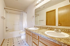 Bathroom cabinet with granite top, two sinks and mirror Stock Photo