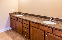 Bathroom Cabinets with Granite Vanity and Tile Floor Royalty Free Stock Photos