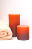 Bathroom Candles. Rich scented bathroom candles and bath towel for a relaxing soak in the bath Stock Photo