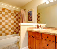 Bathroom with checker board style wall trim. And wooden vanity cabinet stock photos