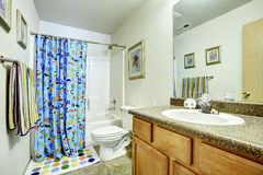 Bathroom with cheerful curtains Royalty Free Stock Image
