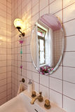 Bathroom in classical style, mirror and sink Royalty Free Stock Photography