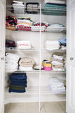 Bathroom Closet. Clean and organized bathroom closet with towels on shelves stock photography