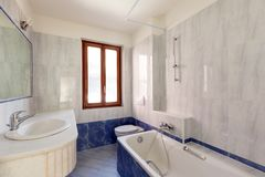 Bathroom in blue with window royalty free stock images