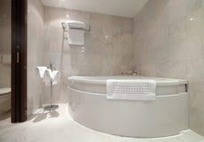 Bathroom with corner bathtub Stock Photography