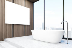 Bathroom corner with a poster. Corner of a bathroom with a bathtub and large horizontal poster hanging on a dark wooden wall. 3d rendering, mock up Stock Photos