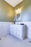 Bathroom corner with white vanity cabinet Stock Photography
