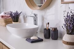 Free Bathroom Counter With Vessel Sink, Accessories And Flowers. Interior Stock Photos - 194107223