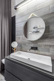 Bathroom with countertop washbasin. And wood effect wall tiles stock photos