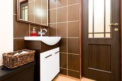 Bathroom in dark tones decorated laconically Royalty Free Stock Photos