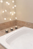 Bathroom decorated with cozy lights and candles Stock Photo