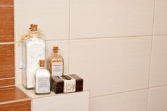 Bathroom decorations. With aromatic powders and ecological soap, arranged on tile shelf Stock Images