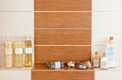 Bathroom decorations. With aromatic powders and ecological soap, arranged on tile shelf Royalty Free Stock Images