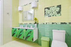Bathroom design with beautiful grass print on bath cabinet and w Stock Photo