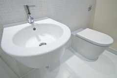Bathroom detail. With hand wash basin, toilet and mosaic tiles Royalty Free Stock Photo
