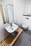 Bathroom detail. Modern minimalist bathroom detail with wooden furniture Royalty Free Stock Images