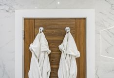Bathroom detail with dressing gowns Royalty Free Stock Images