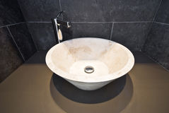 Bathroom detail with round marble wash basin royalty free stock photo