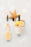 Bathroom Door. Hooks on the bathroom door with pail of soaps and sponge with bubbles royalty free stock photos