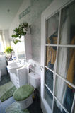 Bathroom door. A bathroom door with glass window and bathroom interior royalty free stock photo