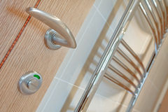Bathroom door handle detail Stock Images