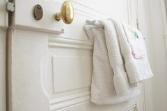 Details of countryside bathroom door. Bathroom door hanging on the towels royalty free stock image