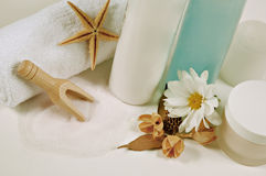Bathroom essentials. Creams,salt,towel and shower gel arrangement with flowers Stock Photography