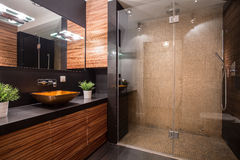Bathroom with fancy shower. New modern bathroom with fancy shower on the wall royalty free stock images