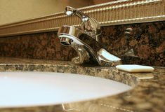 Bathroom faucet. Sink and soap Royalty Free Stock Photo