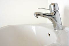Bathroom faucet. Photo from modern bathroom faucet and washbasin Royalty Free Stock Photo