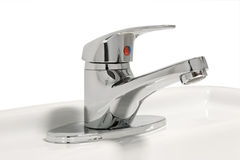 Bathroom faucet. Closeup of bathroom faucet with red and blue symbol royalty free stock image