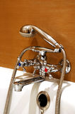 Bathroom faucet. Closeup a modern tap in bathroom Royalty Free Stock Photography