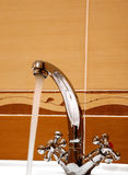 Bathroom faucet. Closeup a modern tap in bathroom Royalty Free Stock Photos