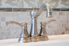 Bathroom faucet. New bathroom faucet with tile back splash Stock Photos