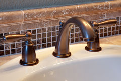 Bathroom faucet. New bathroom faucet with tile back splash Stock Photography
