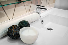 Bathroom faucet mixer towel aroma candles and accessories.  Royalty Free Stock Photos