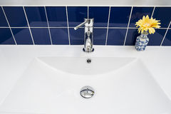 Bathroom Faucet Over White Sink Stock Image