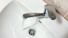 Bathroom faucet stock video