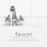Bathroom faucet with running water on a light background Royalty Free Stock Images