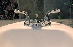Bathroom Faucet On Sink With Dark Back Tile Stock Photography