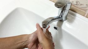 Bathroom faucet stock footage