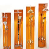 Bathroom faucets in store. Bathroom faucets on orange in the store stock image