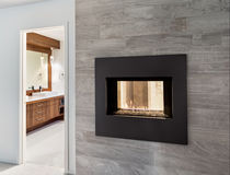 Bathroom and Fireplace in New Home. New luxury bathroom with fireplace royalty free stock image