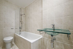 Bathroom with floor to ceiling tiles Royalty Free Stock Photo
