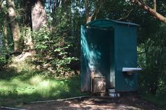 Bathroom in the forrest stock images