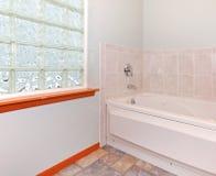 Bathroom glass block window and tub. Royalty Free Stock Photo