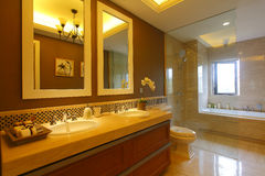 Bathroom. The golden bathroom in a luxury room of hotal Stock Images